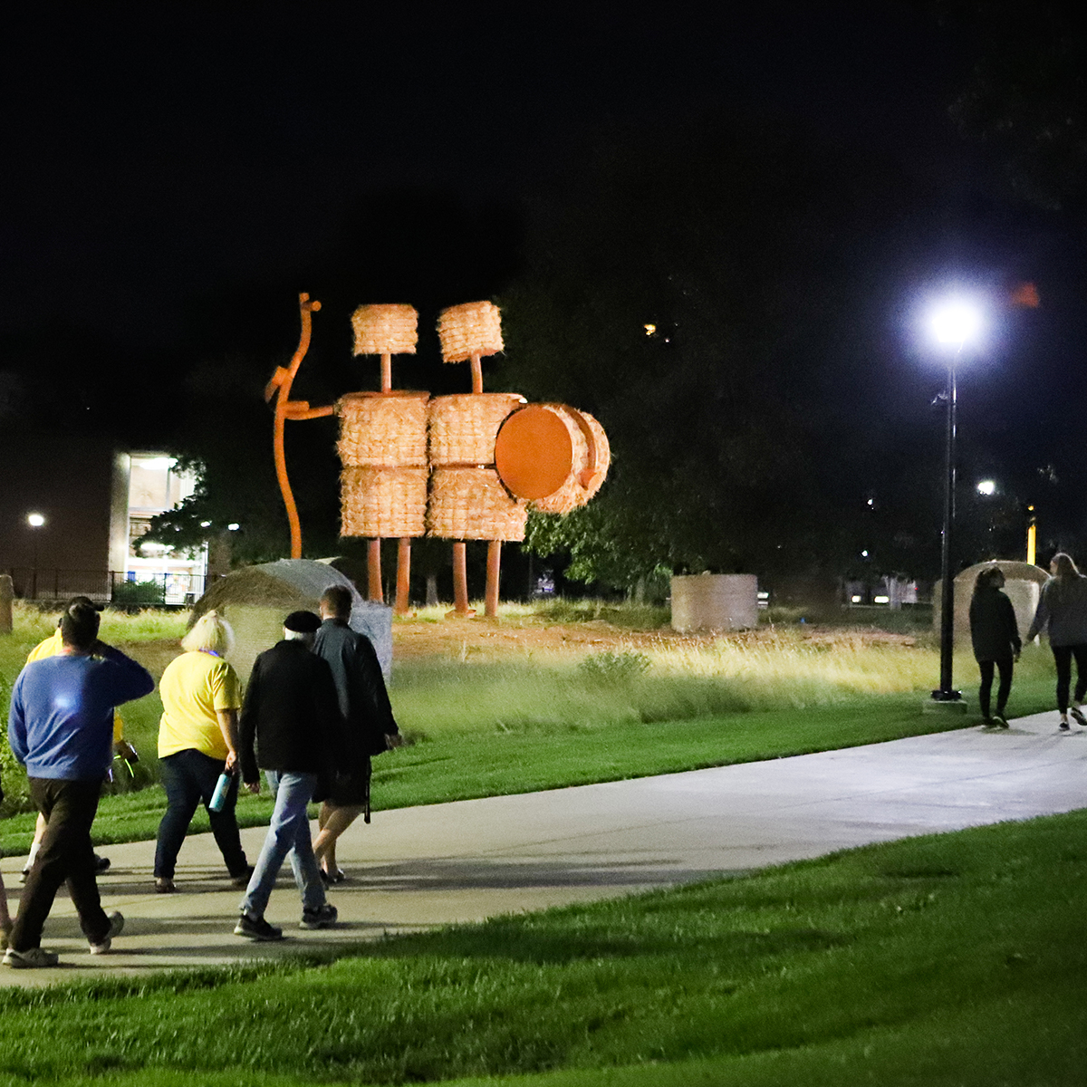 A group of people walking on the side of a road